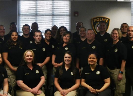 Graduates Cynthia Francis and Dell Scott Garren of Cherryville PD; Amber Chavis, Jennifer Banas, Jovan White, Angela Osborne, Ralph Jefferies, Cindy Ulibarri, Vanessa Rojas, James Sparrow, Morgan Calhoun, and Scot Bryant of Gaston County Probation & Parole; Jeffrey McLeymore, Donnie L. Baynard, Michael Watkins, and Thomas Jackson of Gaston County Sheriff's Office; Laura Biggerstaff, Juan Sepulveda, Brandon Broome, Zachary Lechette, Nerissa Armstrong, Charles Nelson, Brian Atkins, Matthew Willis, and Cody Huffstetler of Gastonia PD, Dispatchers Sherry Hopper and James Wilson, and officers Heather Lloyd, Andrew Rogers, and Gregory Ivester of Gaston County PD, pose for a group photo.