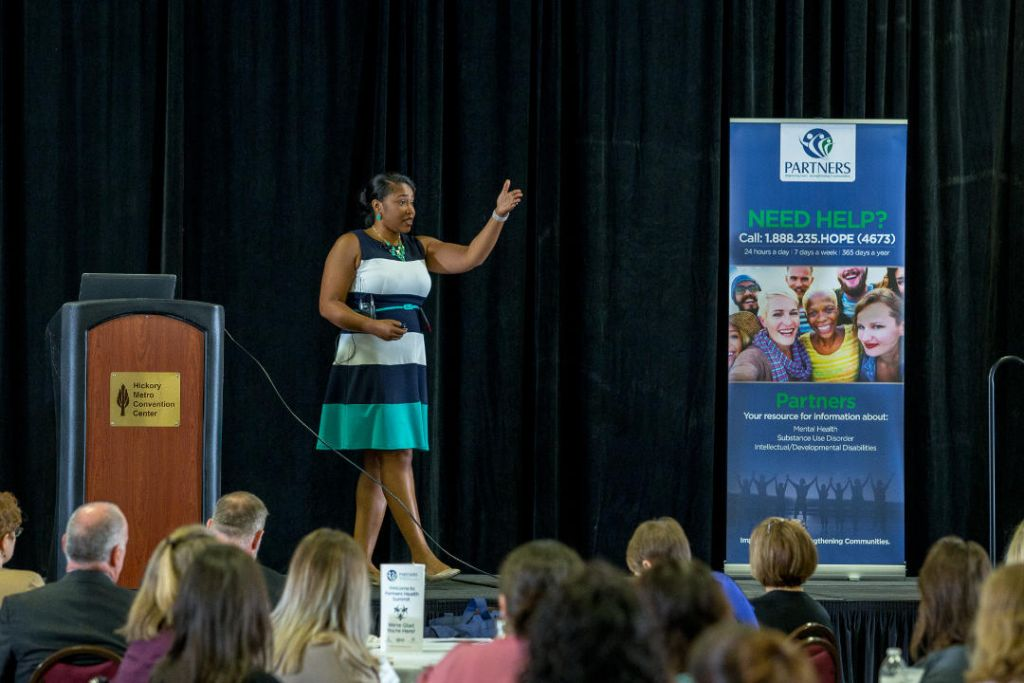 "Jasmine Mickle, project manager for Benchmarks' Partnering for Excellence program, presented ""Understanding the Impact of Traumatic Stress Adolescence,"" during the morning keynote address at the Partners Health Summit on Friday, October 13, 2017, in Hickory, NC."